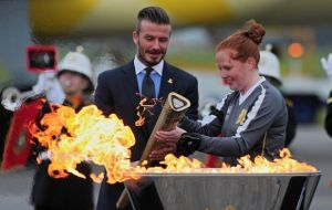 David Beckham lit a cauldron, to mark the flame's arrival on UK soil.