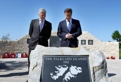 David Cameron is accompanied by NMA chief executive Charlie Bagot-Jewitt during a visit to the Falklands Memorial (Photo: AP)