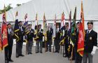Veterans organisations pose with their colours