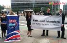 Young Falkland Islanders with a banner displayed before the UN building in New York (Photo: BBC)
