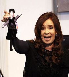 The Argentine president with her presidential doll in black
