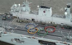 Servicemen on deck recreate the Olympic rings