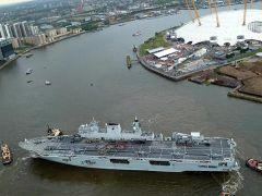HMS Ocean squeezing through the Thames barrier