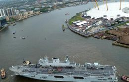 HMS Ocean squeezing through the Thames barrier
