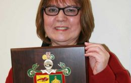 Celia with the plaque thanking the Falklands for the generous donation