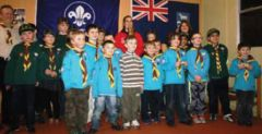 Scouts and beavers line up with Rebecca and the torch