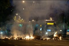 Hooded vandals set on fire public transport buses