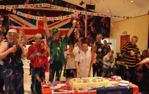 Pantaney proudly cutting the cake & holding her Olympic Torch during the closing ceremony of the Olympic Spirit 2012 event.