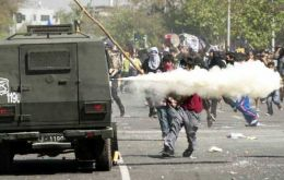 A common scene in Santiago and other Chilean cities: students clash with Carabineros
