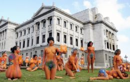 A group of women demonstrated nude outside Parliament in support of abortion