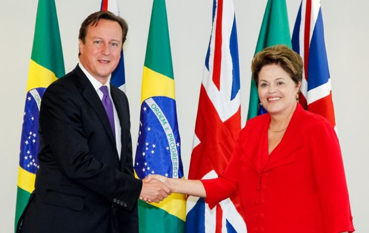 PM Cameron and President Rousseff shake hands at the Planalto Palace