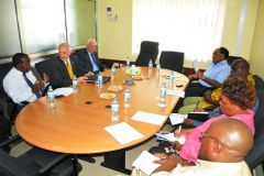 The Acting Managing Editor of TSN Mr. M. Ally (L) MLA Mike Summers (Second L) and the British Deputy HC Mr. J. Chandler at the company's head office in Dar es Salaam (Photo: TSL)