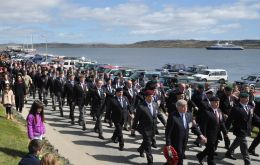Veterans march towards the Cross of Sacrifice
