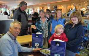 Patrick Watts signing copies of his newly published book 'The Christmas Sports' at the Capstan gift shop in Stanley.