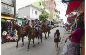 Mounted police patrol the streets of some of the poor areas of the city