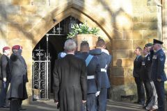 Veterans and serving personnel salute the coffin of Sir Rex Hunt as it is borne into the church (Pic: I McIntyre)