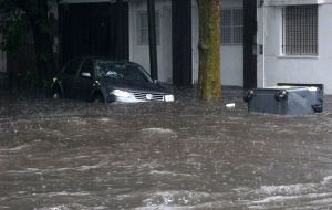 Cars floating in flooded streets of the port area