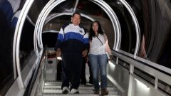 The Venezuelan leader unaided walks down the steps from the plane that brought him from Havana