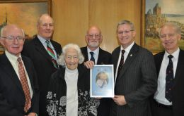 Andrew Rosindell MP with members of the FIA Executive Committee and the portrait of Her Majesty which he has presented to FIA