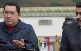 """Choose Maduro (R) as president of the republic,"" Chavez (L) said. ""I am asking you this from all my heart."" (Photo Efe)"
