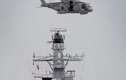 HMS Sutherland and a Merlin helicopter make a routine maritime security patrol (Photo: MoD)