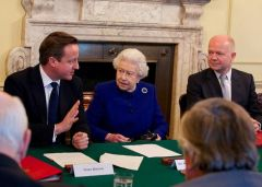 The Queen sat at PM's chair next to Cameron and Hague