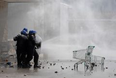 Police with water cannons and tear gas clash with vandals