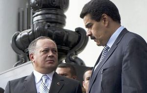 A more flexible and pragmatic Nicolas Maduro will cohabit with hard liner Diosdado Cabello (L)