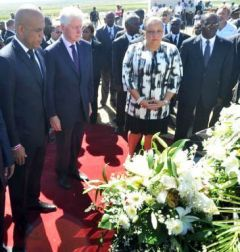President Michel Martelly and former president Clinton as the sombre ceremony