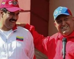 Before leaving for Cuba, Chavez urged his countrymen to support Vice president Maduro (L)