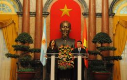 Cristina Fernandez and Truong Tan Sang with Ho Chi Minh overlooking