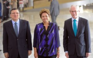 Brazil`s President Dilma Rousseff (C) poses with the President of European Commission, Jose Manuel Durao Barroso (L) and the President of European Council, Herman Van Rompuy (R)