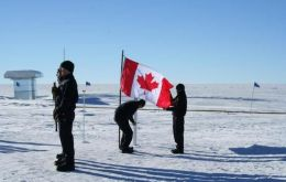 A Canadian flag pays homage to the dead crew { Photo By : Blaise Kuo Tiong, NSF}