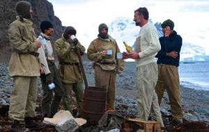 The crew testing the whisky to toast a t Shackleton's grave