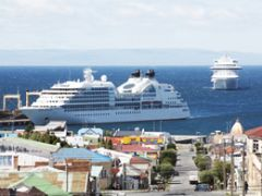 Several cruise vessels on a sunny busy day
