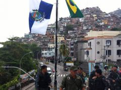 The flags of Brazil and Rio flying after the favela were taken back to government control