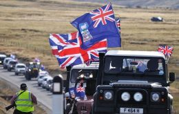 Falkland Islanders in a massive concentration displaying the Union Jack  (Photo: M. Short)