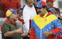 Maduro in his Venezuelan flag colours shirt and Diosdado Cabello (L), both had important announcements to make (Pic. AP)