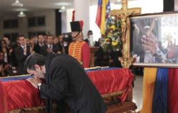The Iranian president broke protocol to touch and kiss the casket and clench his fist in a revolutionary salute.