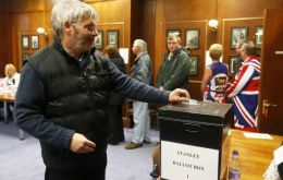 MLA Gavin Short voting at the Chambers in Stanley (Pic EFE)