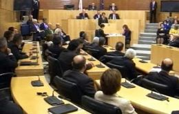 Cypriot parliament rejected a one-off tax on bank deposits, one of several bailout conditions