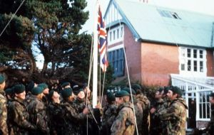 Seventy four days after invasion day Argentine troops surrendered and the Union Jack is hoisted at the Governor's residence
