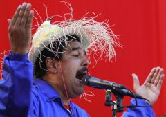 A forceful Capriles blasting incumbent Maduro who turned up wearing a hat with Chavez 'spirit'