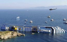 The 'Costa Concordia' on the rocks; the accident cost 32 lives