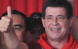President elect Cartes with the red colour of the party celebrates victory