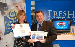 Beauchene Fishing Company owner Cheryl Roberts, as Director of South Atlantic Squid Ltd and Igueldo Fisheries (F.I.) Ltd, accepts the Superior Taste Award for Falkland Islands Patagonian Squid awarded