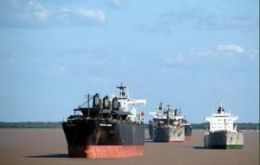 Tens of ships lined up along the Parana and River Place waiting to load