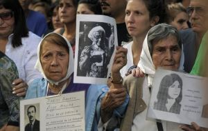Members of the Human Rights organization Madres de Plaza de Mayo Linea Fundadora and other demonstrators hold portraits of people who went missing in the 1976-1983 military dictatorship (AFP)