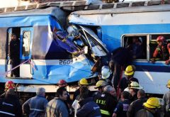 Rescuers desperately try to save people from the wrecked early morning double deck train