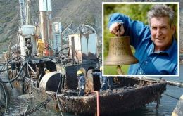 Dr Robb Robinson of the Maritime Historical Studies Centre in Hull, with the bell from the Viola, which is rusting in South Georgia